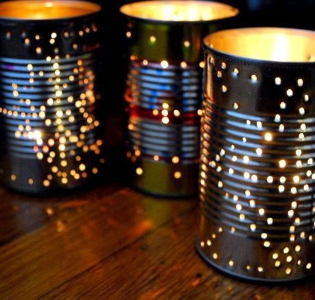 Drill holes into tin cans and put candles in them. Lovely for an outdoor party.