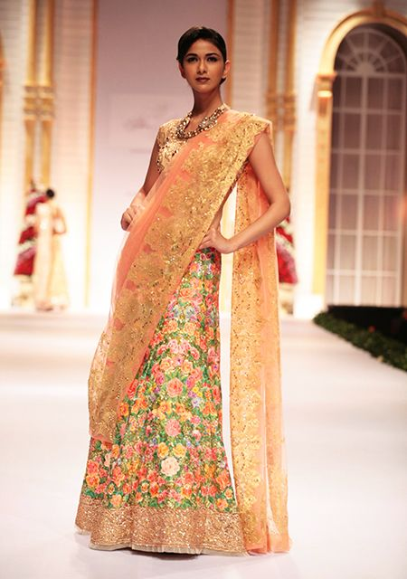 Peach and floral design make this a dreamy Lehenga sari- something that is ideal for spring or summer weddings in 2014! Source: weddingsonline.in