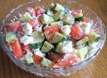 CHUNKY GREEK SALAD   1 medium cucumber, chopped, 7 ounces   2 cups diced tomato, about 12 ounces   1/4 cup red onion, chopped, 1 1/4 ounces   6 ounces feta cheese, crumbled   1/4 cup Caesar salad dressing    Mix all of the ingredients and chill well before serving.    Makes about 8 servings   Do not freeze
