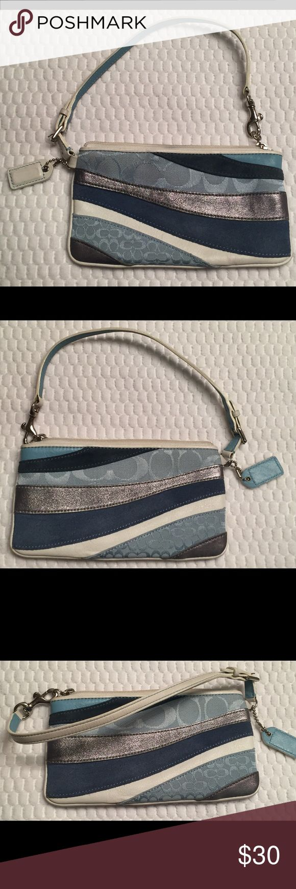 """Coach Blue Patchwork Striped Wristlet Nice used Coach wristlet. Patchwork blue, white and metallic stripes with signature C's. Silver tone hardware, zipper closure, 6"""" attached strap with dog leash clasp.  Approx. size: 7"""" L x 4 1/4"""" H. Strap is lightly dirty but overall nice condition. Coach Bags Clutches & Wristlets"""