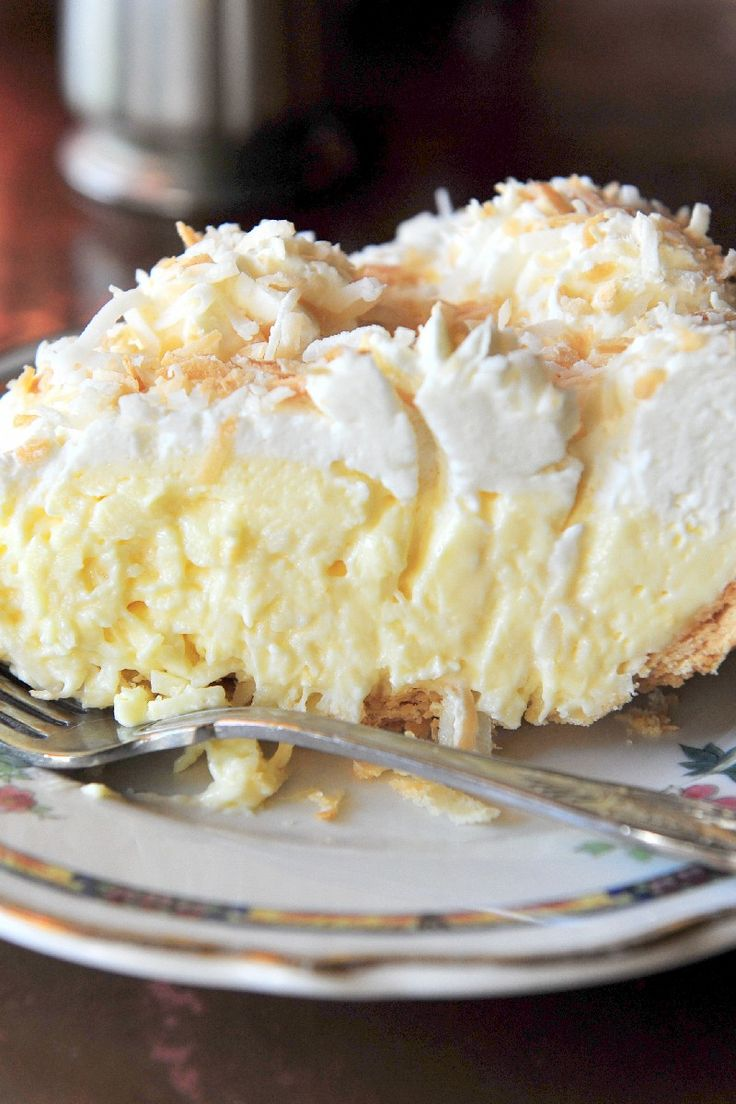 Recipe including course(s): Entrée; and ingredients: coconut, egg, flour, frozen whipped topping, half-and-half, pie shells, salt, sugar, vanilla extract