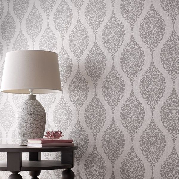 This stunning textured wallpaper adds a truly enchanting touch to any home. With a raised grey damask pattern sitting upon a textured pearlescent backdrop, this charming motif bounces light around the home. Perfect for rooms with low lighting or tall walls that cry out for a stylish design; this feminine damask wallpaper features the subtle twinkle of embossed glitter to capture the eye of your guests.