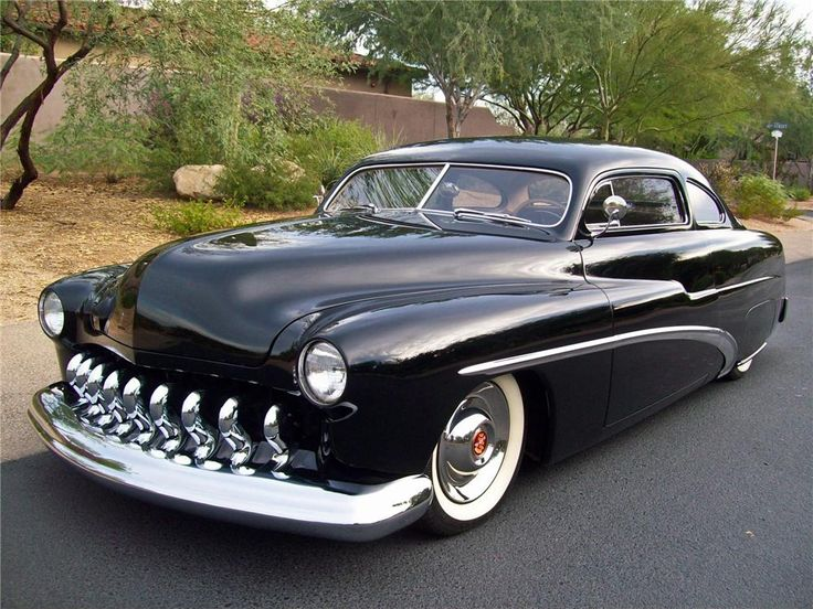 Stella, Dez's 1951 Mercury Coupe (although her's has dark purple ghost flames painted on the nose as well).