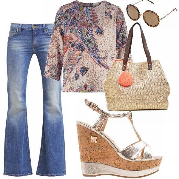 Un tuffo negli anni 70! Outfit giornaliero a base di jeans, camicia e le immancabili zeppe in sughero con un tocco, però, di luminosità. La borsa capiente è l'ideale per fare shopping in centro, gli occhiali tondi danno continuità allo stile!