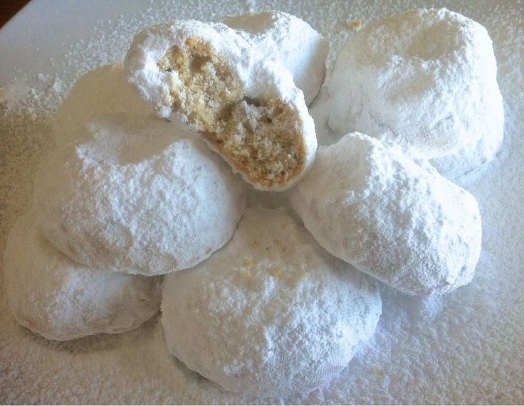 Kourabiedes - home made butter cookies recipe.  A traditional Greek treat, packed with the aromas of  fresh butter and roasted almonds and garnished with luscious layers of  powdered sugar...