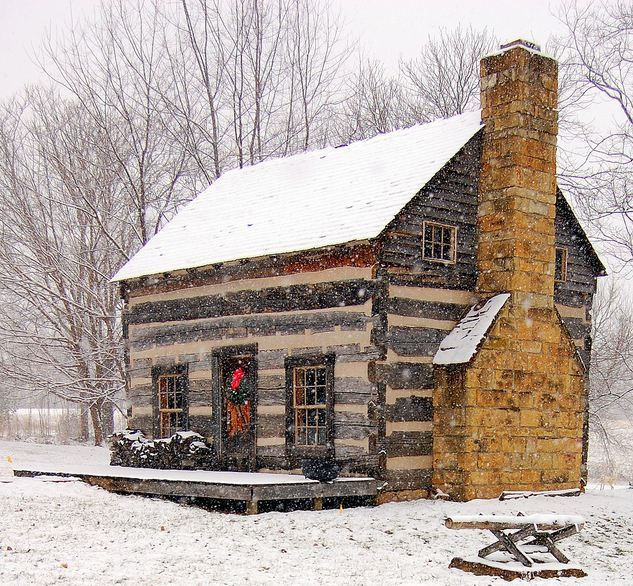 Wood cabin in the snow