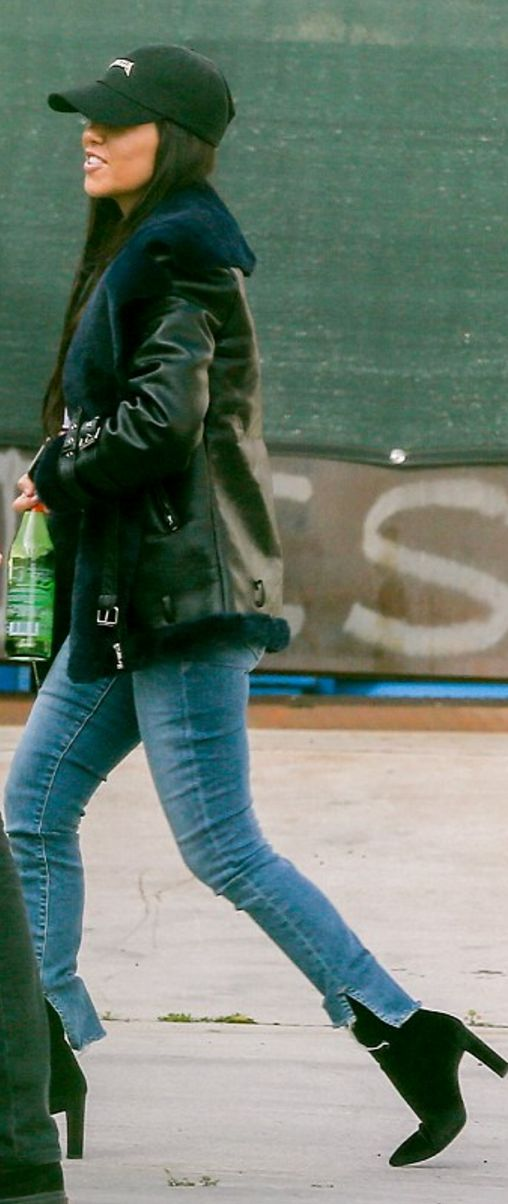 Who made  Kourtney Kardashian's shearling and leather jacket, black ankle boots, and baseball hat?