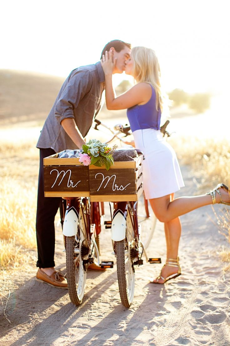 """Engagement photo idea - couple  poses + bikes with """"Mr."""" and """"Mrs."""" signs {Courtesy of CHARD Photo}"""