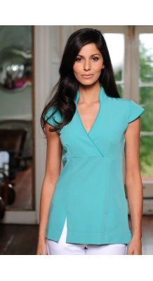 Contemporary style white beauty tunic with wrap over bodice and mandarin collar neckline