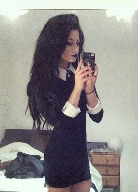 collared black dress, black hair, and black lips... sophisticated goth