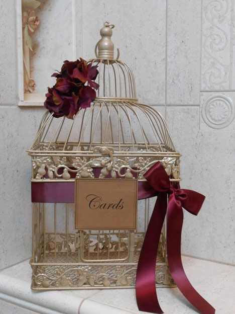 birdcage wedding decor with marsala ribbon
