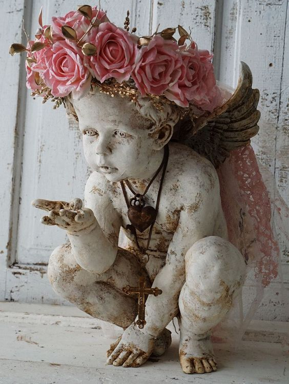 Cherub angel statue w/ handmade ornate pink rose crown shabby cottage chic embellished angelic figure home decor anita spero design   The cherub is 15 tall. I painted this cherub in a homemade cracky cream white paint and distressed it to add age, texture and character. I made the crown using handmade and hand dyed pretty summer pink roses, that I made from heavy parchment type paper. . There is a thin strip of salvaged rhinestones at the bottom of the crown.You can also see golden fillers…