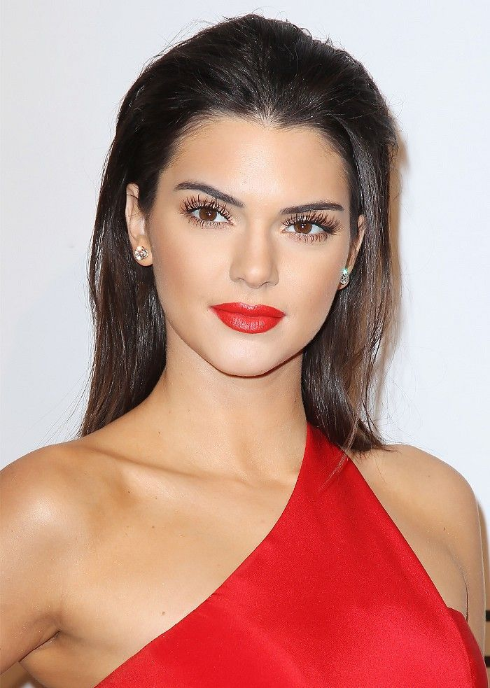 Kendall Jenner's lush lashes, red lips, and slicked-back hair.