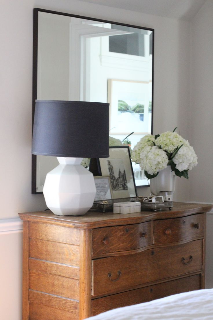 vintage oak dresser becomes stylish with a modern mirror and geometric  white lamp. kelly g