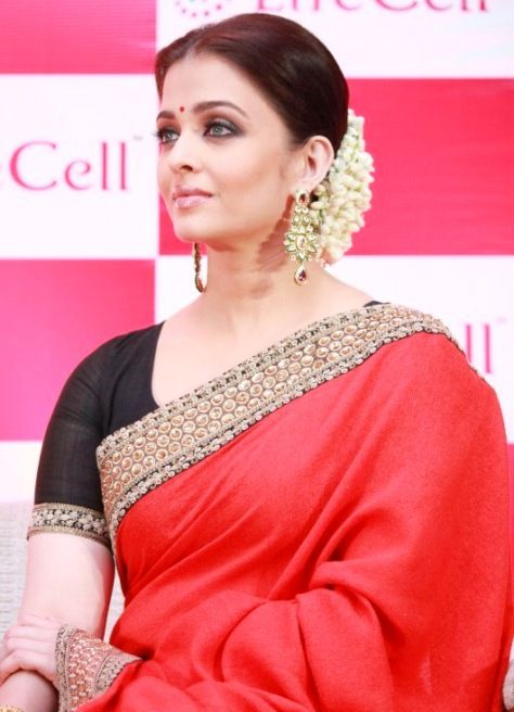 Ashwariya Rai Bachchan in a beautiful Red Sabyasachi saari