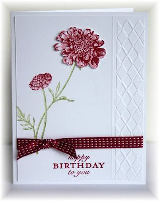 The card - flower is from SU Field Flowers, sentiment is from Savvy Stamps.  I used just part of the embossing folder (from Darice) along the edge and then scored  two lines next to that.  Colors are pear, raspberry and white.
