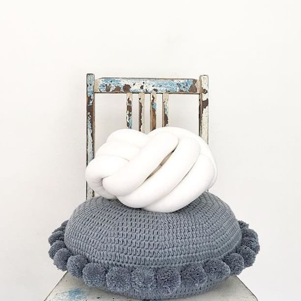@closely.knit has a new cushion out.. it is has pom pom's and comes in grey!! #winwin #lemonadelusts