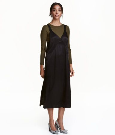 Black. Straight-cut, calf-length dress in woven fabric with a slight sheen. V-neck, slightly wider shoulder straps, and slits at sides. Partly lined at top.