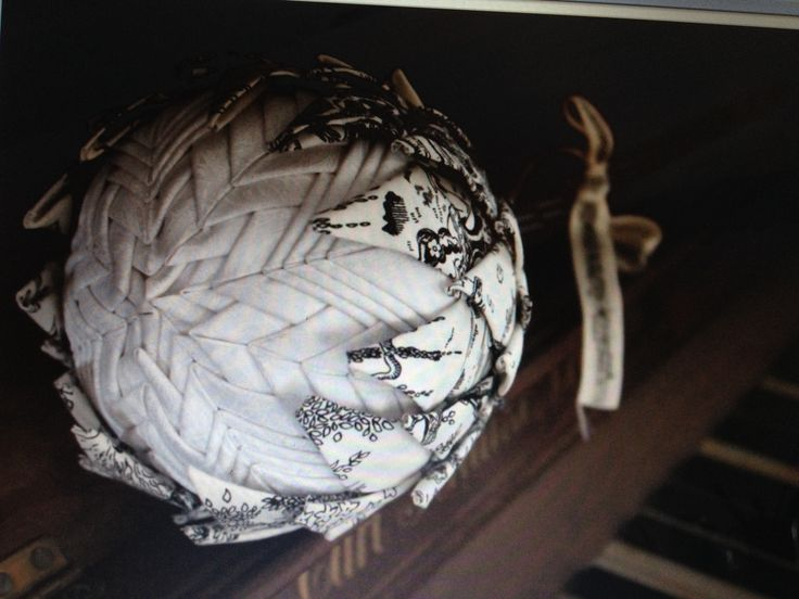 A vintage inspired black & white protea lying artfully on an old piano - for sale on Facebook at An Owl & a Protea's page
