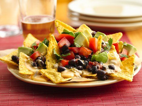 Beer Queso Nachos - Nachos smothered with beer-spiked queso dip are sure to be a hit at any party.