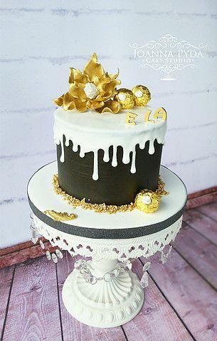 joannapydacakestudio black chocolate ganache cake with white drip and gold sugar flower