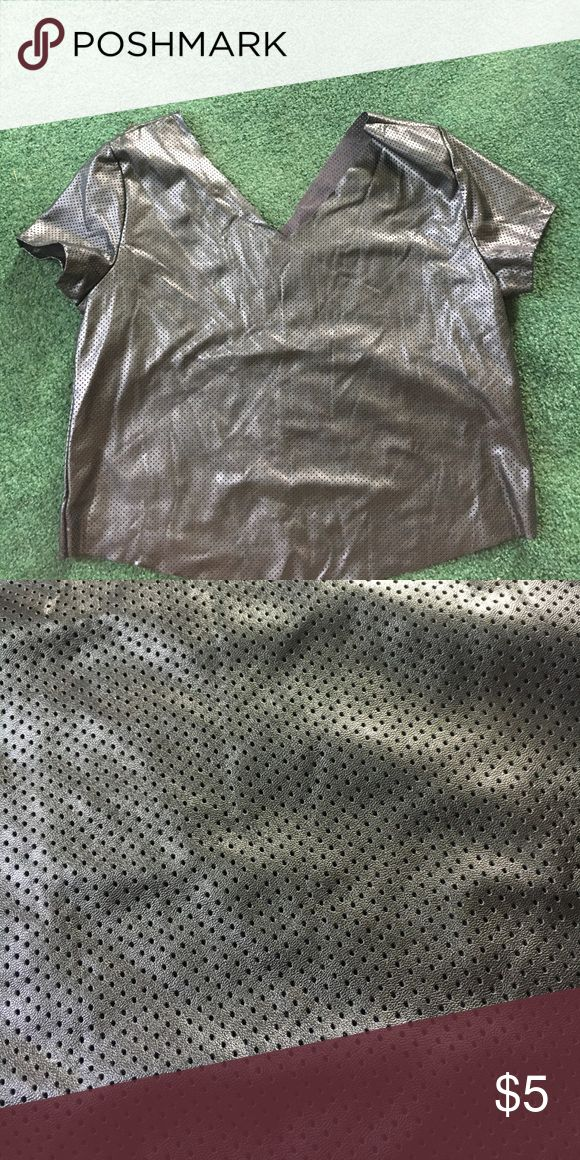 T shirt Faux leather t shirt from rue 21 i don't know what size it is since I cut the part where the tag would be trying to get it to be comfortable but it didn't work. Never worn cause I just didn't like it Rue21 Tops Crop Tops
