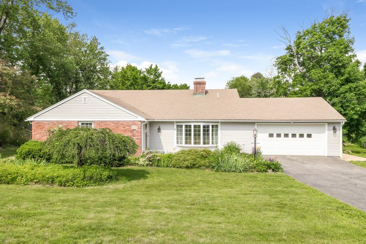 Updated in-town 2,404 square foot split level home with 4 bedrooms, 3 full bathroom and the most gorgeous level 1.36 acres - looks just like a park. Walk to restaurants, shopping and schools. Newer Kitchen with a pantry closet, center island and stainless steel appliances.