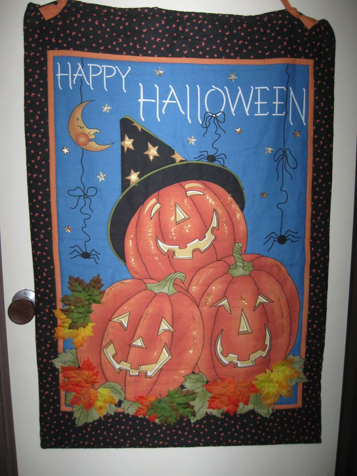 Halloween panel - this is several years old and I stitched and embelished it before I took up quilting.  It still hangs pride of place on the front brick wall at Halloween.