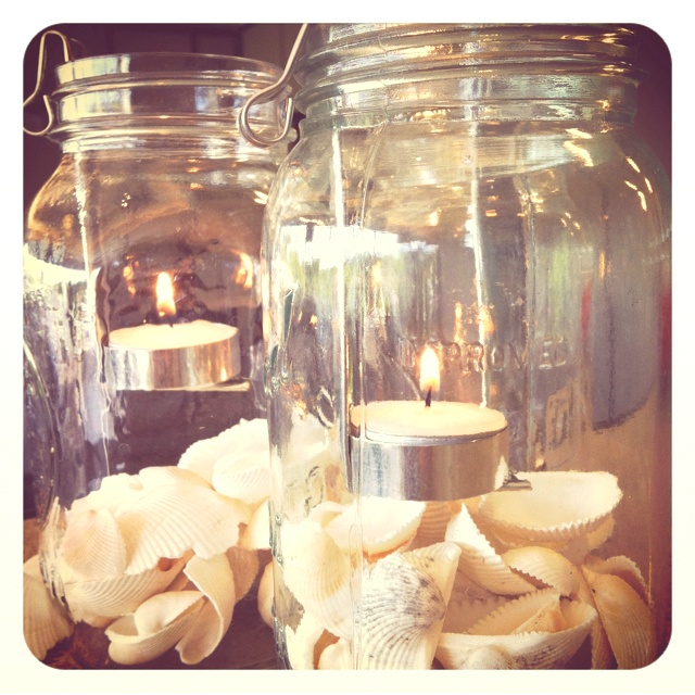 Bridal shower centrepiece. Mason jars with shells and a tea light holder.