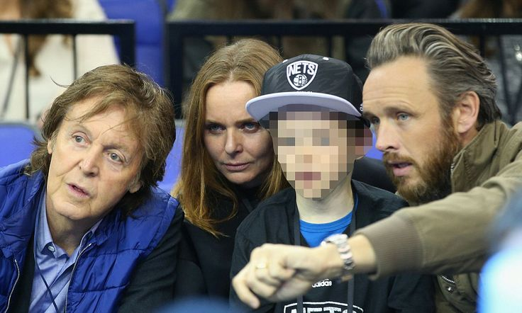 Come together! Paul McCartney takes daughter Stella and family out to a basketball game along with his wife Nancy - It was a real family affair on Thursday night at London's 02 Arena when Paul McCartney stepped out with his American-born wife Nancy Shevell...