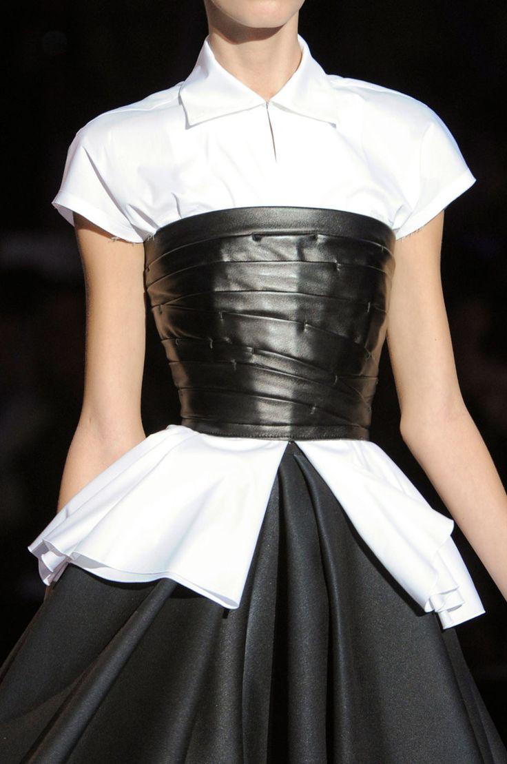 Okay, so not this goth... but my tan ruffled corset would look really cute with a capped sleeve high collar white button up.