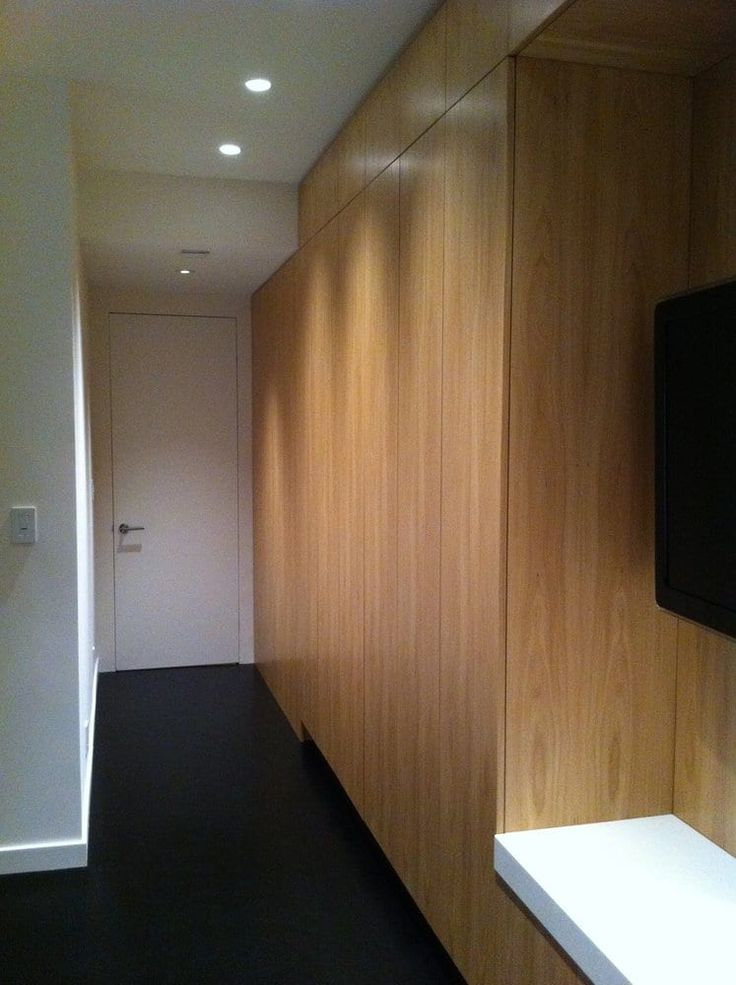 Photo of The Urban Builder - San Francisco, CA, United States. Master entryway, flush mount door, floor to ceiling cabinets, and ebony hardwood floor
