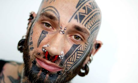 A visitor to a tattoo convention in London. Photograph: Sarah Lee for the Guardian