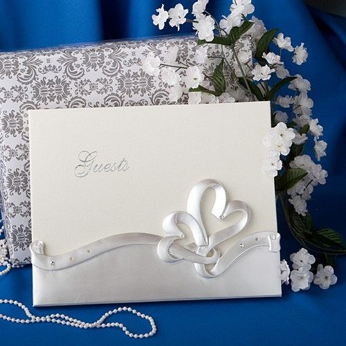 Your  guests' names will be a permanent part of your love story with this  interlocking hearts design wedding guest book from Fashioncraft's Finishing Touches Collection    Your guest list includes cherished relatives and friends who have come  together to share in your joy!  And this  elegant interlocking hearts guest book makes it easy to record their names  while also providing a lasting keepsake that holds memories for years to come. Perfect  as an accessory for a heart themed wedding or…