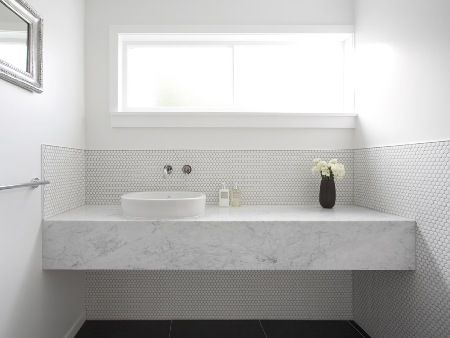 a bathroom alteration completed mid last year - carrara marble benchtop and circular mosaics