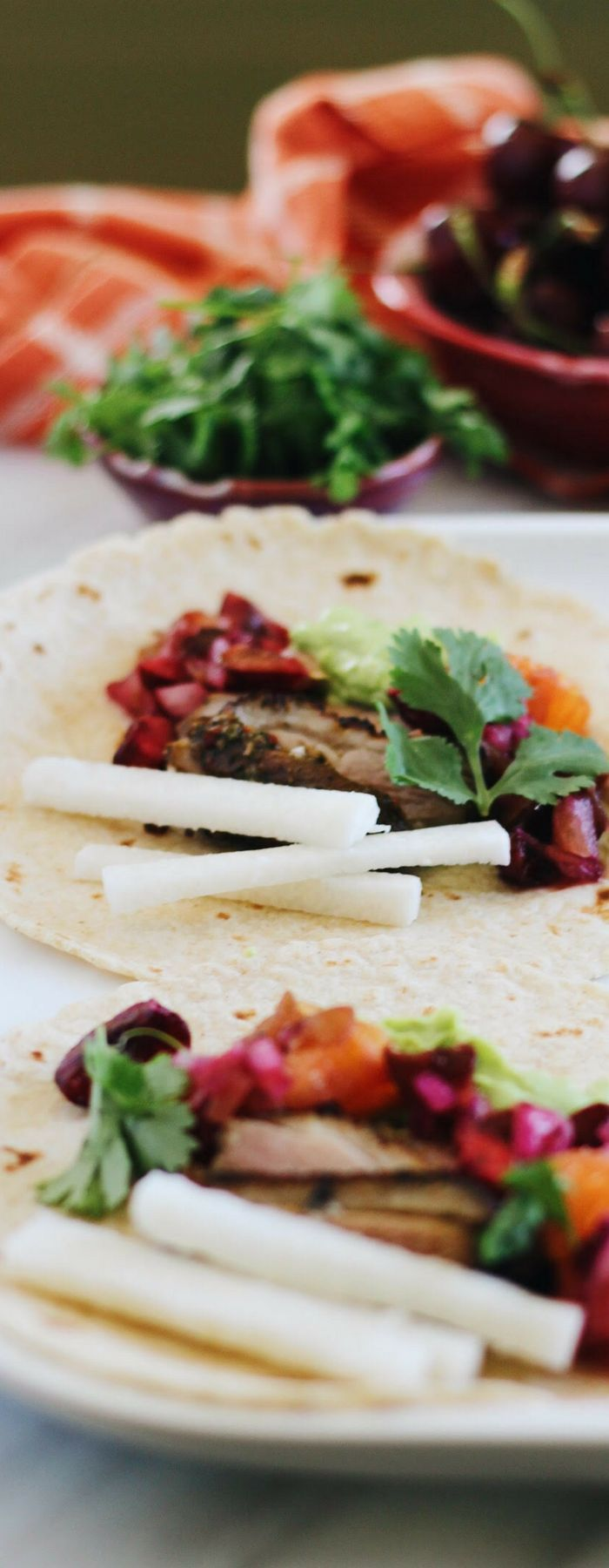 Duck confit tacos with a fresh cherry-orange salsa is the perfect summer meal! Whether you buy duck confit or make your own, this is a great dinner party recipe to impress your guests.