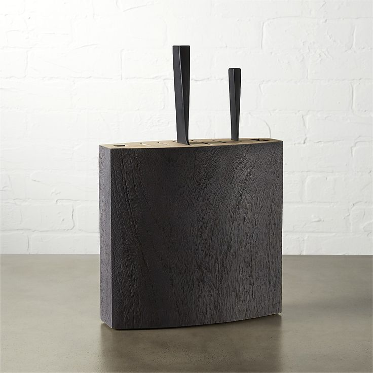 Shop stow knife block.   Architectural storage block is cleverly crafted for space-saving and function.  Dark mango wood features six slots: two short, two medium, two long plus an opening for kitchen shears and sharpening rod.