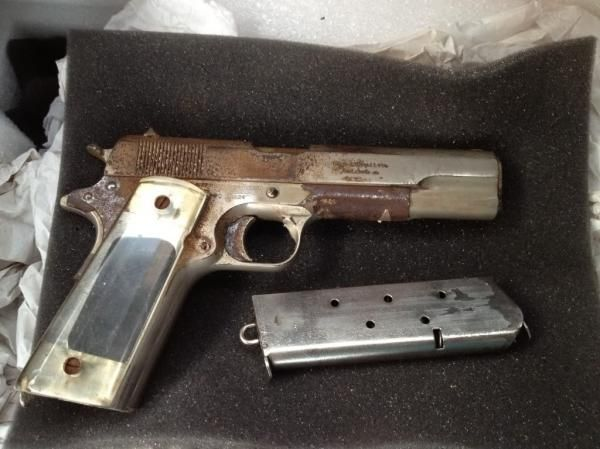 A well-worn US Navy PBY pilot's 1918-made Colt with repurposed plastic grips. These allowed the flyboy to see the rounds left in the magazine through the visible witness holes. source