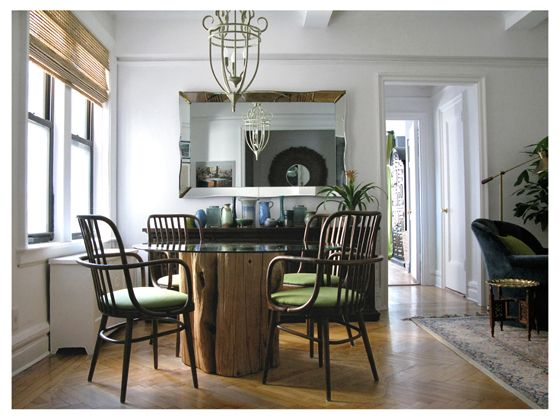 Upper West Side apartment designed by Jill Danyelle features a tree trunk base table with vintage bentwood chairs.