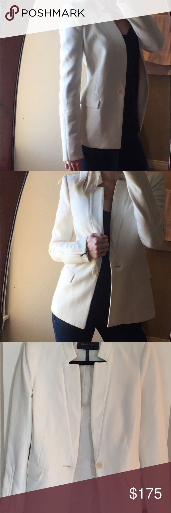 """BCBG Max Azria White Blazer Dressy white blazer from BCBG Max Azria! Worn once and in like new condition. Measurements: 17"""" shoulder to shoulder, 24"""" top to bottom in back and 26"""" top to bottom in front, 26"""" sleeve length BCBGMaxAzria Jackets & Coats Blazers"""