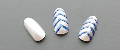 CND Education Ambassador, Candice Manacchio created a glitzy chevron design exclusively for @ELLE Magazine (US).com. For step-by-step instructions on how to re-create this wintery, wearable look, click here: http://www.elle.com/beauty/nail-art-designs?click=main_sr#slide-1