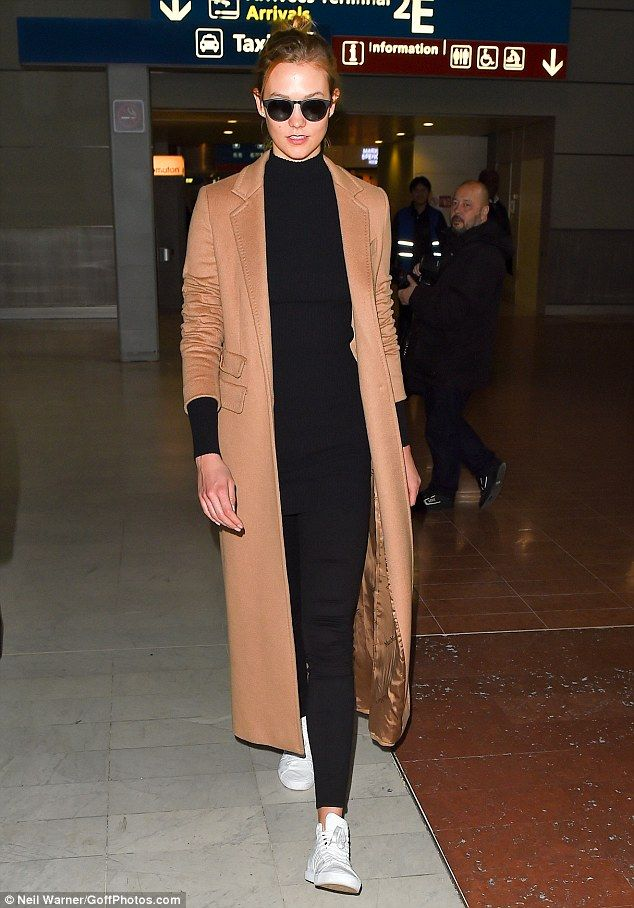 Sleek and sophisticated: Karlie Kloss sported an all-black ensemble and sleek camel coat as she jetted into Paris for Fashion Week