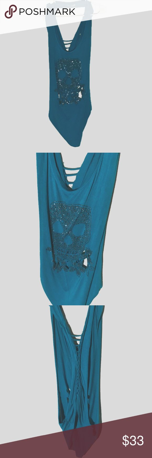 ✂️ Cut up turquoise skull muscle tank/tee ✨to purchase • www.revampdlife.com  this is a cut up muscle tank/tee. It is super stretchy turquoise fabric with a rhinestone skull on the front. The backups sliced & braided/weaved. This would go great over a bandeau, bathing shot or Cami. Lightweight and super cute! Size medium.  #turquoise #skull #rhinestone #embellished #cutup #weave #braid #muscletank #muscletee #layer #summer #stretch #revampdlife #danamariedior reVamp'D Tops Muscle Tees