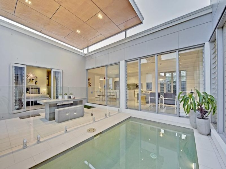 9 Foxwood Cct, Wakerley, Qld 4154. Chic Contemporary Elegance: Cool and crisp tones, complimented by the ultra-stylish and low maintenance polished concrete floors. The Lobby, main living/dining area, master bedroom and second rumpus area all enjoying a view of the alfresco dining area and plunge pool. The seamless design, the perfect entertainer, allowing the chef to still be the life of the party from the kitchen, whilst cooking up a storm for guests in the main living or alfresco area.