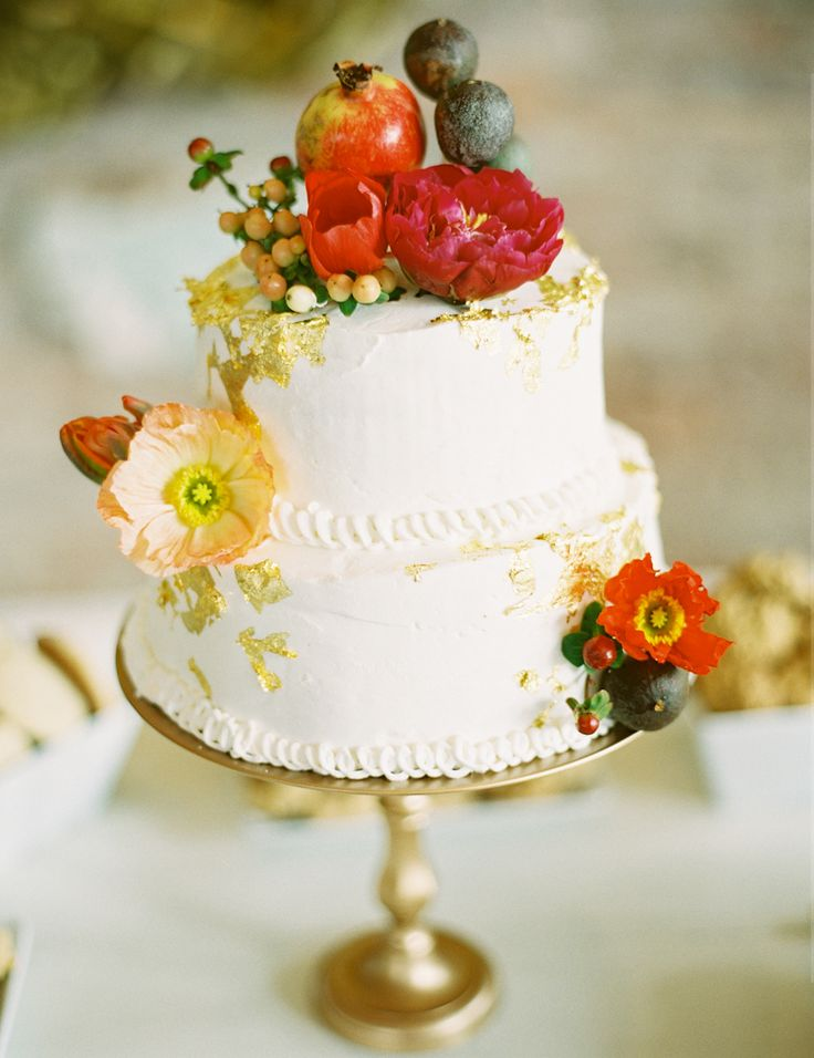 Simple cake topped with fruit and poppies