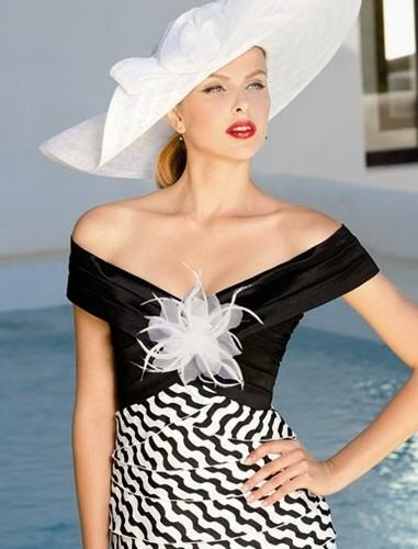 Stylish formal daywear with black and white stripes by Sonia Pena. #mother #bride #dress