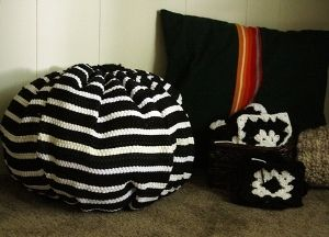 Want to know how to make a bean bag chair from some inexpensive rugs? Check out these recycled rug poufs from Heather Mann and you can make chic poufs for your home using materials from the dollar store!