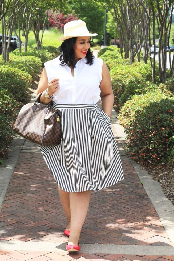 This is NOT an A-Line skirt. I wouldn't tuck the shirt in (or is this actually a dress???) and the bag adds bulk to her silhouette. It's not a terrible look, quite cute, and the vertical stripes are spot on. But for most petite Plus Sized Apples, a simple A line skirt, top that skims the curves (this one cuts her in half!) worn over the skirt, little wedge heels and a slim structured bag, would alter the look entirely, and trick the eye into imagining you taller and slimmer.