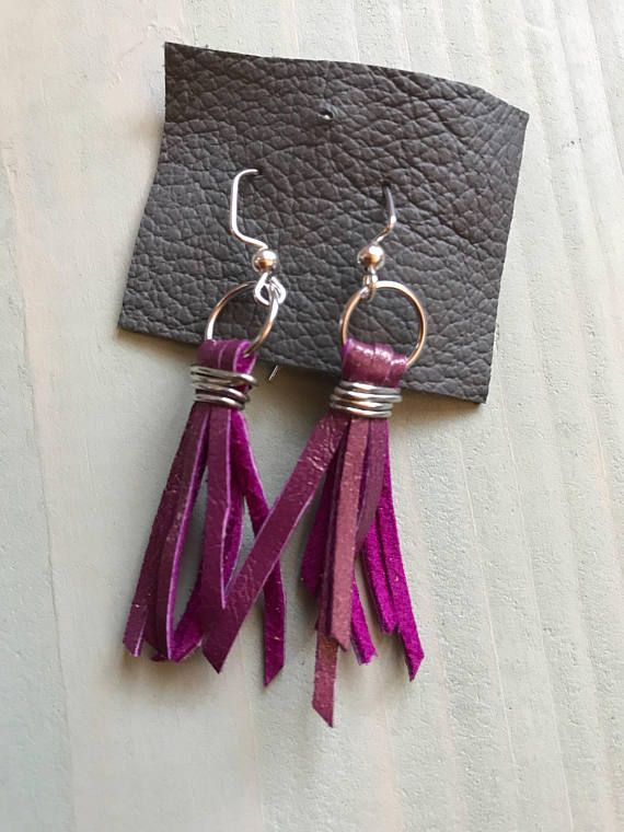 Nice pair of earrings in Fuchsia pink leather Several strips attached with a delicate silver wire