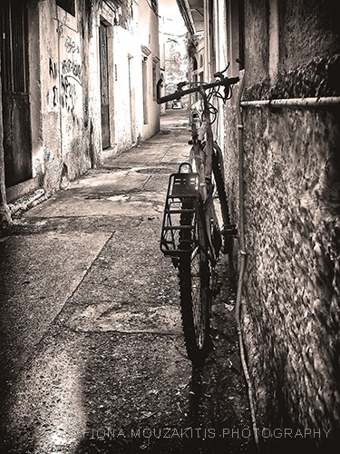 CITY STREET. Bicycle in the back street, Corfu, Greece.